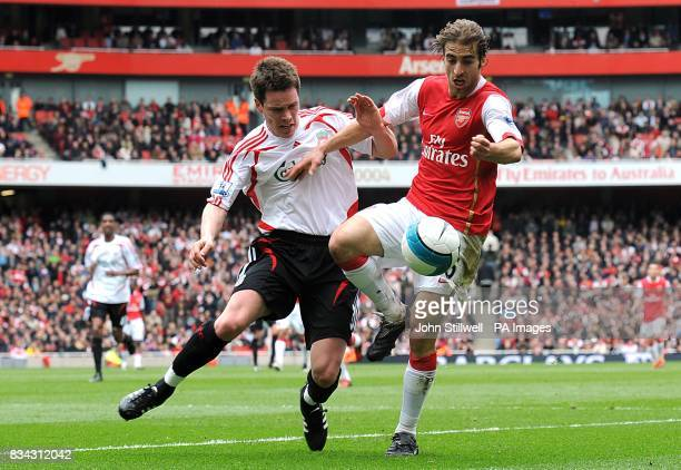 Arsenal's Mathieu Flamini and Liverpool's Steve Finnan battle for the ball