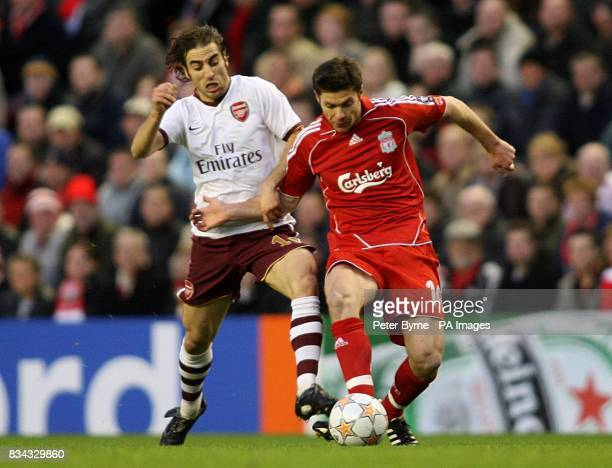 Arsenal's Mathieu Flamini and Liverpool's Xabi Alonso battle for the ball