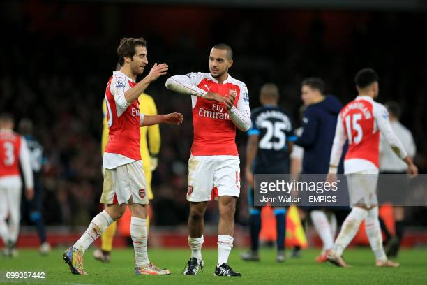Arsenal's Mathieu Flamini and Theo Walcott celebrate victory after the final whistle