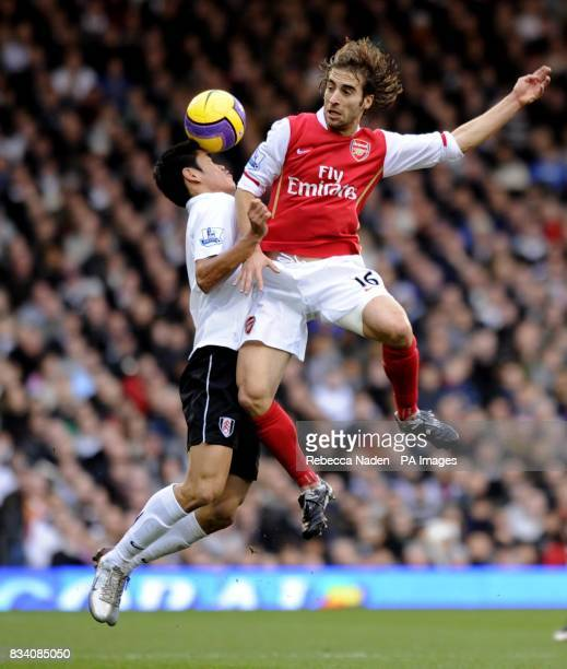 Arsenal's Mathieu Flamini battles for the ball during the Barclays Premier League match at Craven Cottage London
