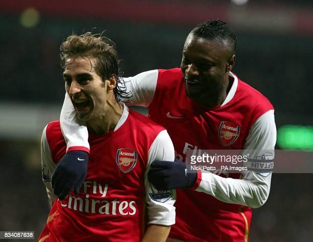 Arsenal's Mathieu Flamini celebrates scoring his sides second goal of the game