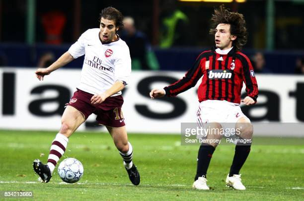 Arsenal's Mathieu Flamini in action with AC Milan's Massimo Oddo during the UEFA Champions League match at San Siro Milan Italy