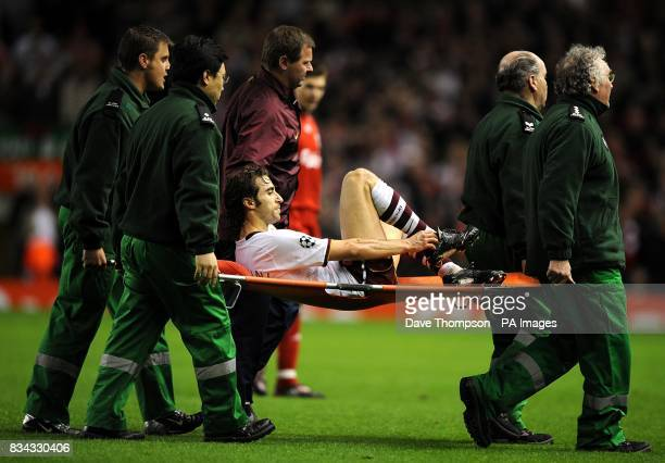 Arsenal's Mathieu Flamini is stretchered off with an injury