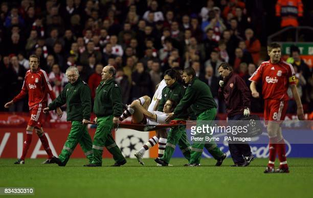 Arsenal's Mathieu Flamini leaves the field after picking up an injury
