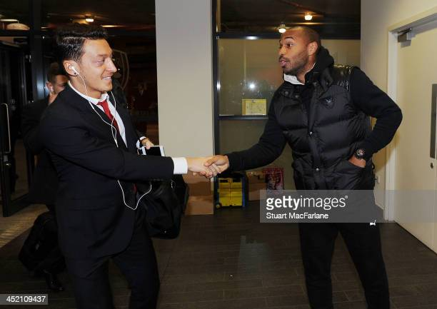 Arsenal's Mesut Oezil shakes hands with former player Thierry Henry before the UEFA Champions League match between Arsenal and Olympique de Marseille...