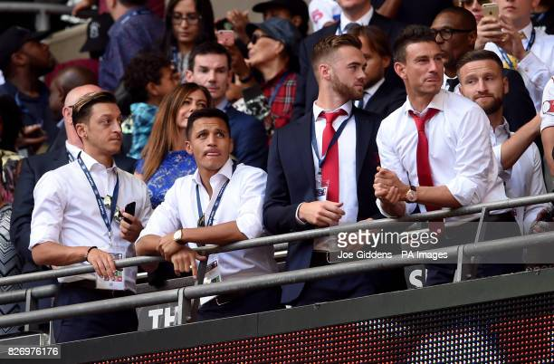 Arsenal's Mesut Ozil Alexis Sanchez Calum Chambers and Laurent Koscielny during the Community Shield at Wembley London
