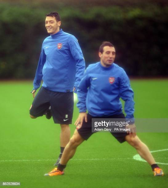 Arsenal's Mesut Ozil and Santi Cazorla during a training session at London Colney St Albans