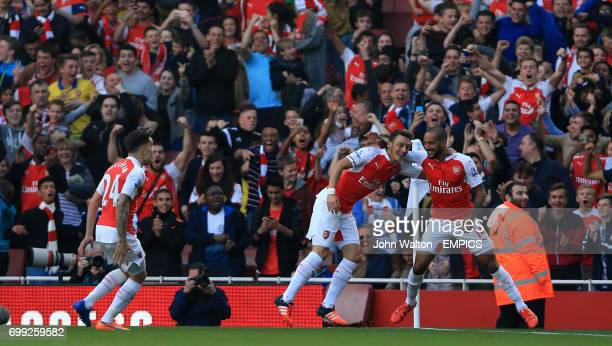 Arsenal's Mesut Ozil celebrates scoring his side's second goal of the game with teammate Theo Walcott