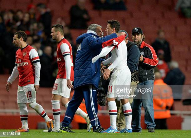 Arsenal's Mesut Ozil gives his shirt to Chelsea manager Jose Mourinho after the match