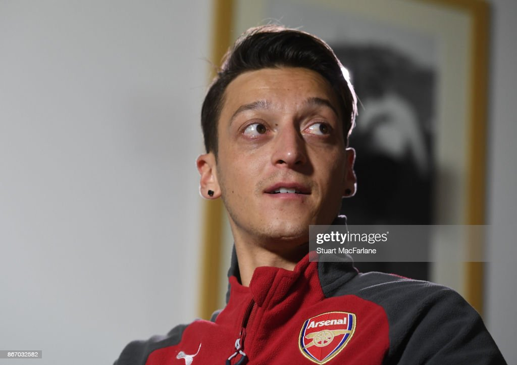 Arsenal's Mesut Ozil speaks to the media after a training session at London Colney on October 27, 2017 in St Albans, England.