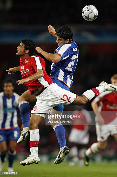 Arsenal's Mexican Carlos Vela competes for the ball against FC Porto's Romanian Cristian Sapunaru during the Champions League Group G match at the...