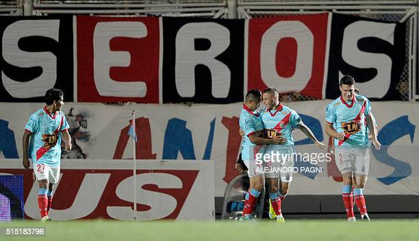 Arsenal's midfielder German Ferreyra celebrates with teammates after scoring the team's first goal against San Lorenzo during their Argentina First...