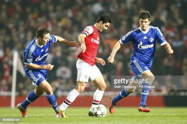 Arsenal's Mikel Arteta and Schalke 04's KlaasJan Huntelaar and Roman Neustadter battle for the ball