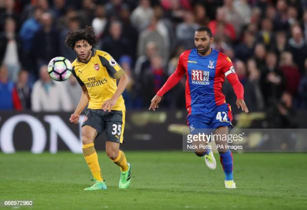 Arsenal's Mohamed Elneny and Crystal Palace's Jason Puncheon battle for the ball during the Premier League match at Selhurst Park London