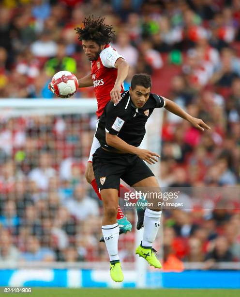 Arsenal's Mohamed Elneny and Sevilla's Wissam Ben Yedder battle for the ball in the air during the Emirates Cup match at the Emirates Stadium London