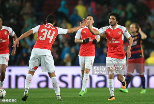 Arsenal's Mohamed Elneny celebrates scoring his side's first goal of the game with teammate Francis Coquelin