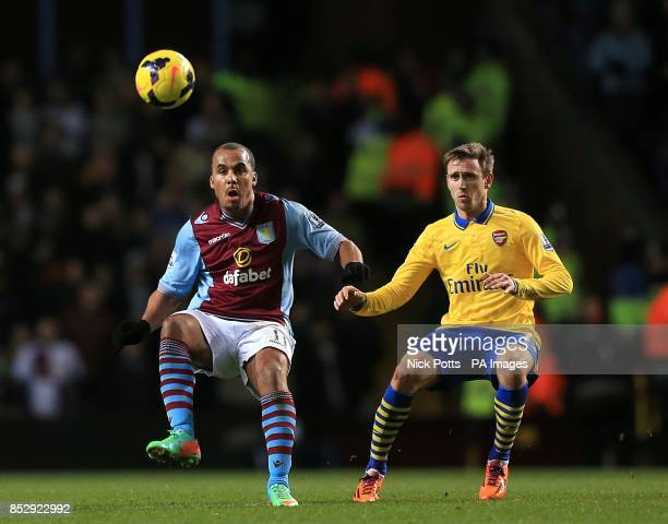 Arsenal's Nacho Monreal and Aston Villa's Gabriel Agbonlahor battle for the ball