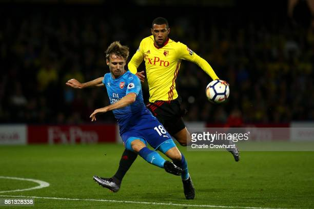 Arsenal's Nacho Monreal clears the ball away from Watford's Etienne Capoue during the Premier League match between Watford and Arsenal at Vicarage...