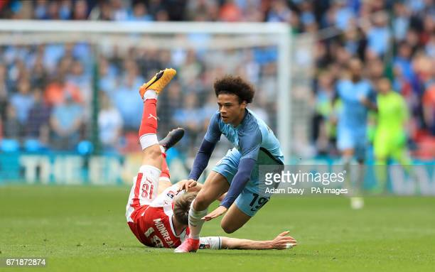 Arsenal's Nacho Monreal falls during a challenge with Manchester City's Leroy Sane during the Emirates FA Cup Semi Final match at Wembley Stadium...