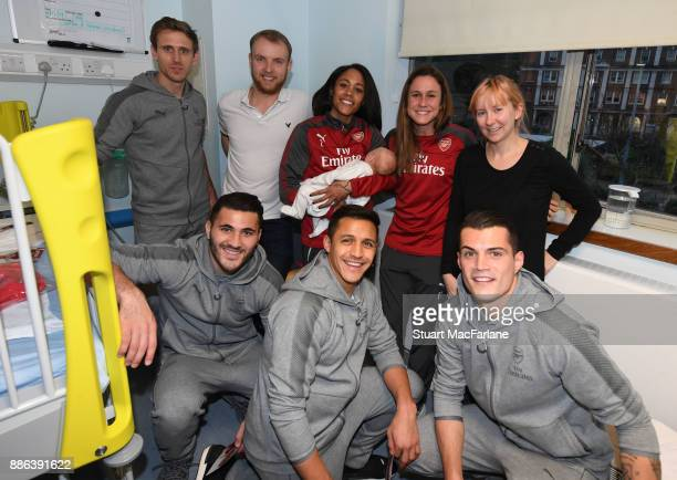 Arsenal's Nacho Monreal Sead Kolasinac Alex Scott Alexis Sanchez Heather O'Reilly Granit Xhaka visit the Whittington Hospital on December 5 2017 in...