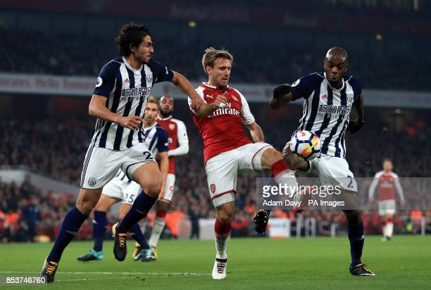 Arsenal's Nacho Monreal takes on West Bromwich Albion's Allan Nyom and Ahmed Hegazy during the Premier League match at the Emirates Stadium London