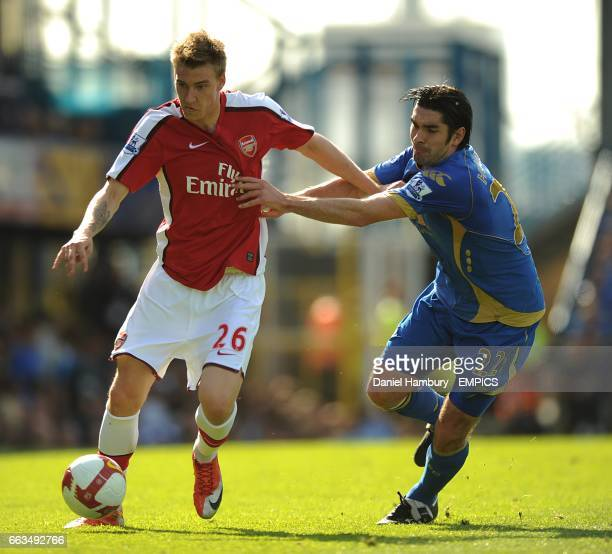 Arsenal's Nicklas Bendtner and Portsmouth's Richard Hughes battle for the ball