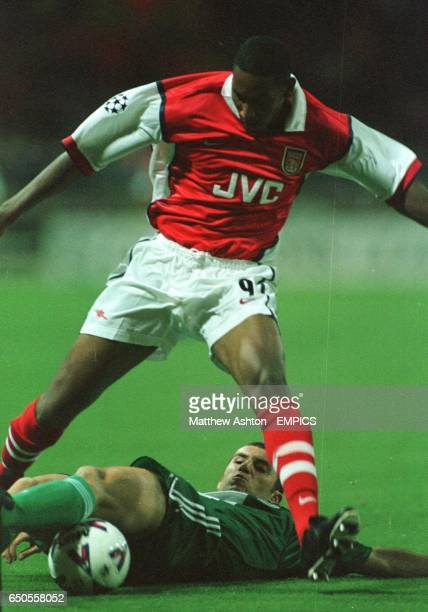 Arsenal's Nicolas Anelka is tackled by Panathinaikos's Ioannis Goumas