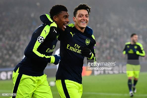 Arsenal's Nigerian forward Alex Iwobi celebrates after scoring a goal with his teammate Arsenal's German midfielder Mesut Ozil during the UEFA...