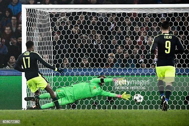 Arsenal's Nigerian forward Alex Iwobi scores a goal during the UEFA Champions league Group A football match between FC Basel 1893 and Arsenal FC on...
