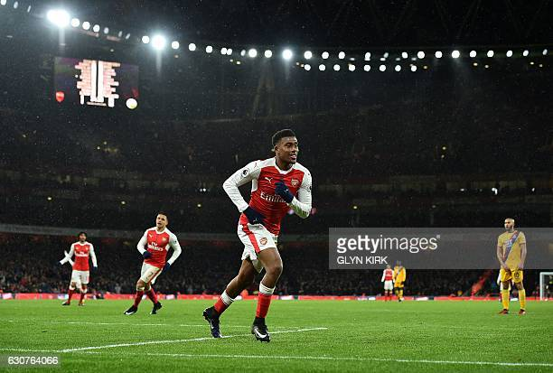 Arsenal's Nigerian striker Alex Iwobi celebrates scoring his team's second goal during the English Premier League football match between Arsenal and...
