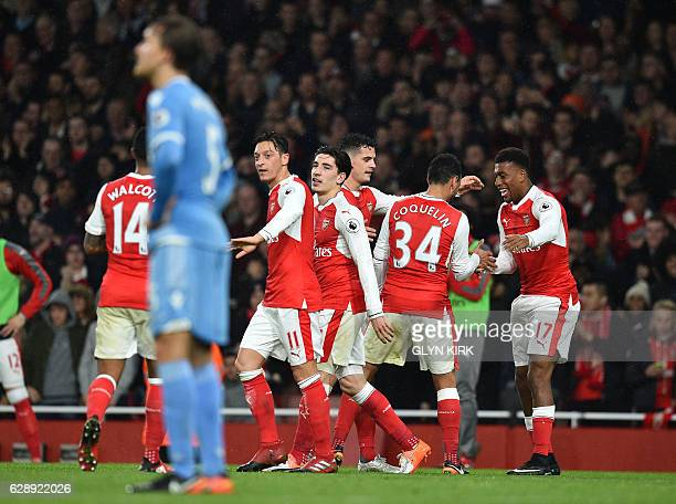 Arsenal's Nigerian striker Alex Iwobi celebrates with teammates after scoring their third goal during the English Premier League football match...