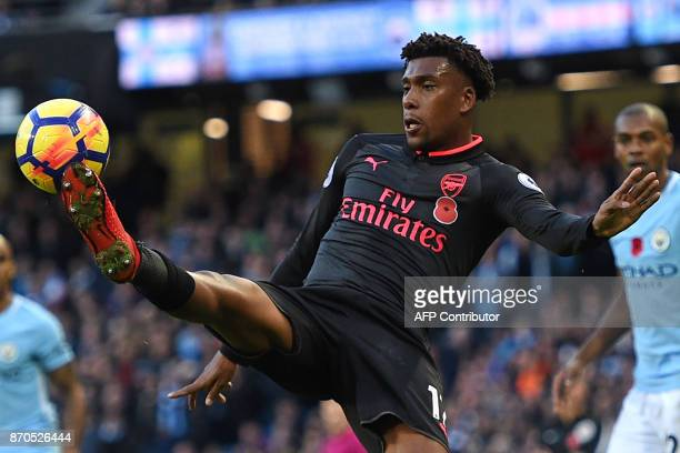 Arsenal's Nigerian striker Alex Iwobi controls the ball during the English Premier League football match between Manchester City and Arsenal at the...