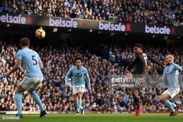 Arsenal's Nigerian striker Alex Iwobi has an unsuccessful attempt on goal during the English Premier League football match between Manchester City...