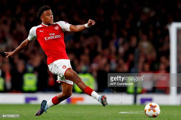 Arsenal's Nigerian striker Alex Iwobi passes the ball during the UEFA Europa League Group H football match between Arsenal and FC Cologne at The...