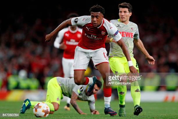 Arsenal's Nigerian striker Alex Iwobi runs away from FC Cologne's Serbian midfielder Milos Jojic during the UEFA Europa League Group H football match...
