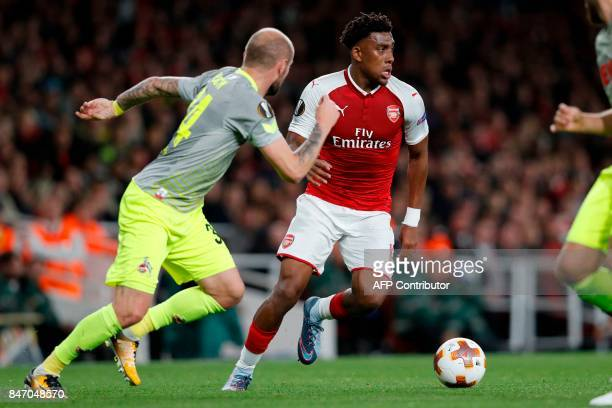 Arsenal's Nigerian striker Alex Iwobi runs with the ball during the UEFA Europa League Group H football match between Arsenal and FC Cologne at The...