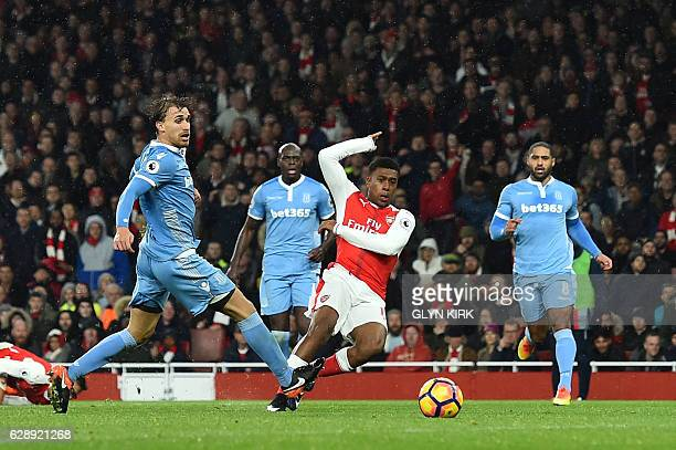 Arsenal's Nigerian striker Alex Iwobi shoots and scores during the English Premier League football match between Arsenal and Stoke City at the...