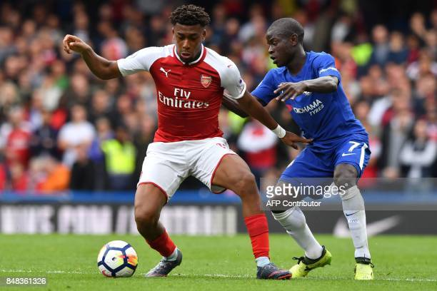 Arsenal's Nigerian striker Alex Iwobi vies with Chelsea's French midfielder N'Golo Kante during the English Premier League football match between...