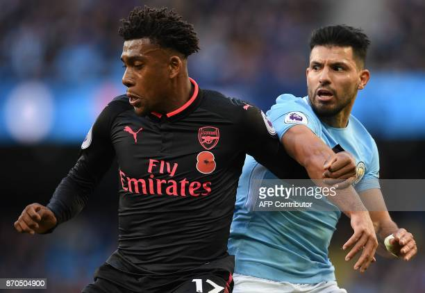 Arsenal's Nigerian striker Alex Iwobi vies with Manchester City's Argentinian striker Sergio Aguero during the English Premier League football match...