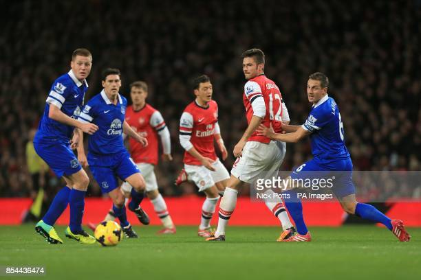 Arsenal's Olivier Giroud and Everton's Phil Jagielka battle for the ball