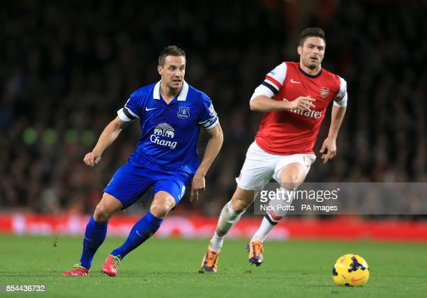 Arsenal's Olivier Giroud and Everton's Phil Jagielka in action