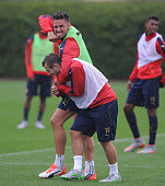 Arsenal's Olivier Giroud and Jack Wilshere mess around during a training session at London Colney on July 24 2015 in St Albans England