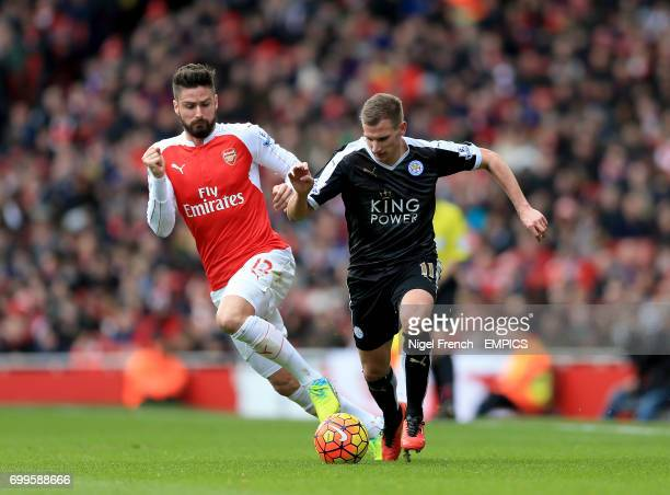 Arsenal's Olivier Giroud and Leicester City's Marc Albrighton battle for the ball