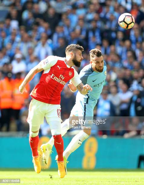 Arsenal's Olivier Giroud and Manchester City's Nicolas Otamendi battle for the ball in the air