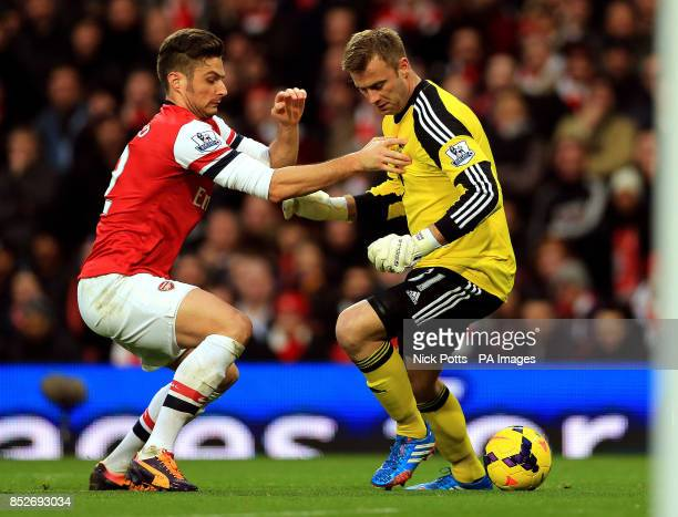 Arsenal's Olivier Giroud and Southampton's Artur Boruc battle for the ball during the Barclays Premier League match at Emirates Stadium London