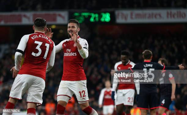 Arsenal's Olivier Giroud celebrates scoring his side's fifth goal with Sead Kolasinac during the Premier League match between Arsenal and...