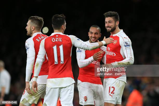 Arsenal's Olivier Giroud celebrates scoring their second goal of the game with teammates Aaron Ramsey Mesut Ozil and Theo Walcott