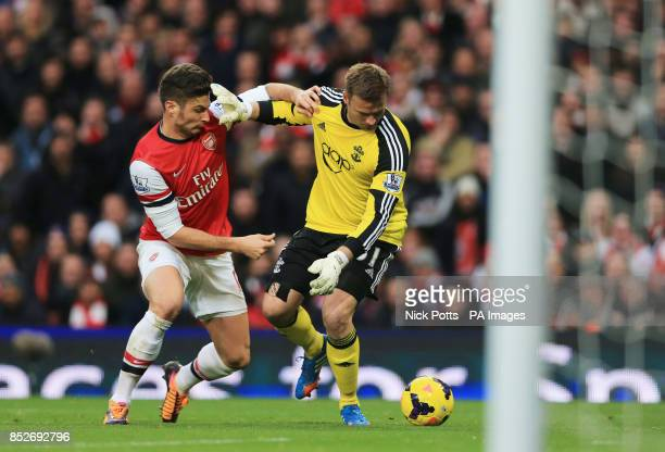 Arsenal's Olivier Giroud challeges Southampton's Artur Boruc to then go on and score during the Barclays Premier League match at Emirates Stadium...