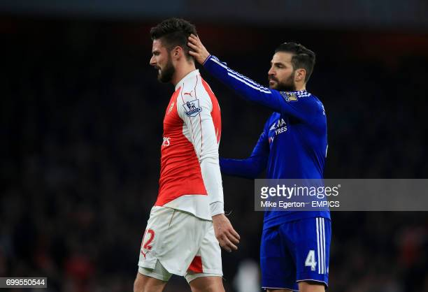 Arsenal's Olivier Giroud is consoled by Chelsea's Cesc Fabregas after being substituted early in the game
