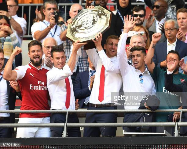 Arsenal's Olivier Giroud Laurent Koscielny Per Mertesacker and Gabriel celebrate after the FA Community Shield match between Chelsea and Arsenal at...